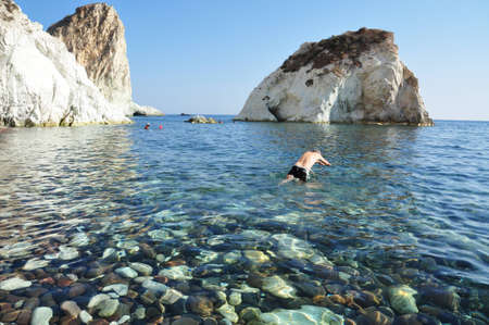 taking the plunge into the crytal clear water of white beach