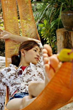 Beautiful Asia woman relaxing on hammock