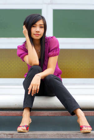 young woman sitting on the step