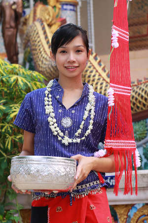 Traditionally dressed woman in temple on Songkran Festival in Chiang mai, Thailand photo