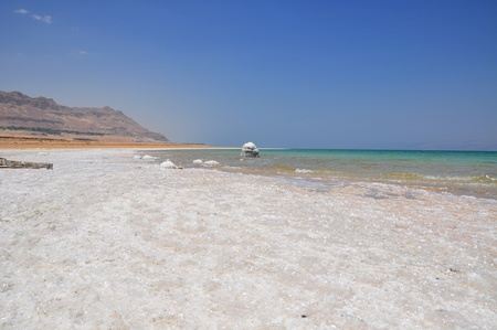 Bulders of salt along the salty coast of the green-blue dead sea Stock Photo - 16750251
