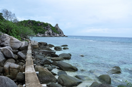 Walkway over the rocks to a secluded beach, Surat Thani Province Thailand Stock Photo