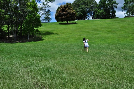 Young woman walking up a hill