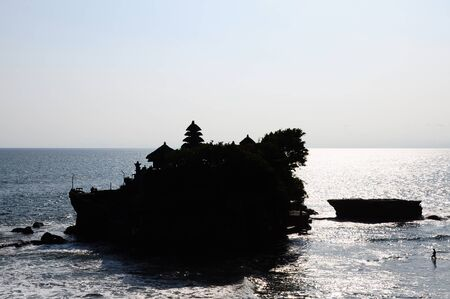 Silhouette of a man walking in the sea at low tide to Tanah Lot temple, Bali, Indonesia Stock Photo - 17116966