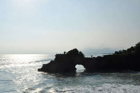 Pura Batu Bolong or  rock with a hole  the small temple situated on the rocks Stock Photo
