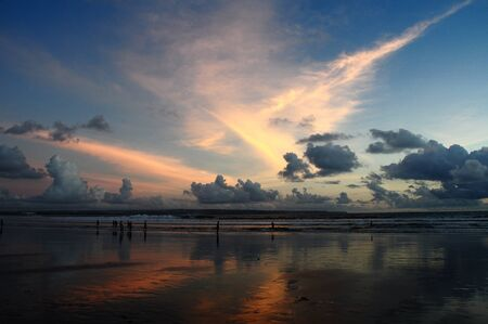 Beautiful sunset at seminyak beach in Bali, Indonesia photo