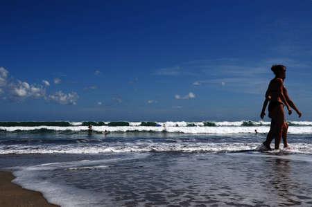 seminyak: surfing at seminyak beach, Bali, indonesia
