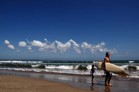 Bali, Indonesia, Photo taken at 14th May 2011- Sufers visit Seminyak Beach is favored by the great  wave that is ideally for surfing adventures
