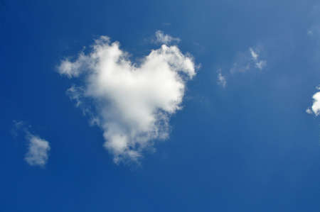 Cloud changing in the shape of a heart photo