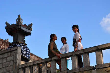 Bali, Indonesia, Photo taken at 19th May 2011- Three Bali woman have native dress on in temple balcony Stock Photo - 17146473