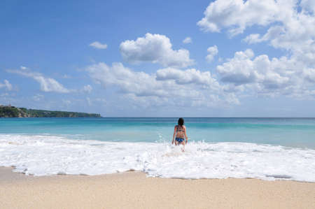 Image of a woman standing on a beautiful beach on Bali island Stock Photo - 17183831