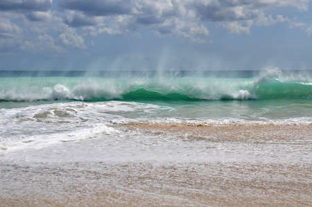 Spray from the breaking wave on Dreamland Beach photo