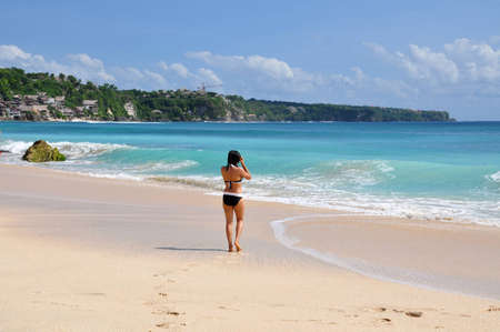 nice accommodations: A female swimmer walking towards the ocean