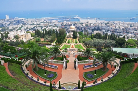 View of Bahai gardens nestled in the middle of the mountains slopes of the Haifa city  photo