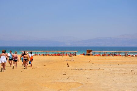 Israel, Photo taken at August 2012-A Tourists going to take a deep in the Dead sea