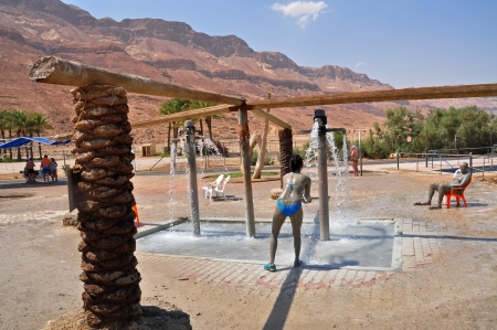 Israel, Photo taken at August 2012-A tourist having a shower After taking a mud bath  Stock Photo - 17464656