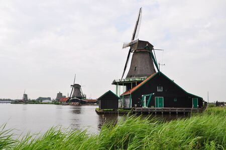 volendam: Image of Windmill village of Volendam in a cloudy day at Dutch countryside, Netherlands