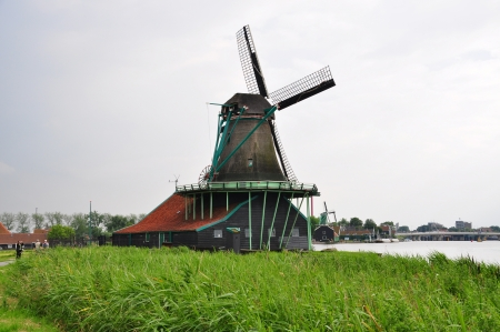 Image of Windmill village of Volendam in a cloudy day at Dutch countryside, Netherlands photo