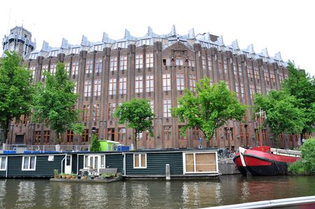Houseboats in Amsterdam canal Stock Photo - 17510675