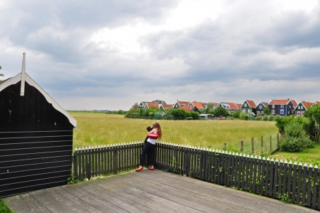 Photographer shooting the beautiful view of dutch countryside