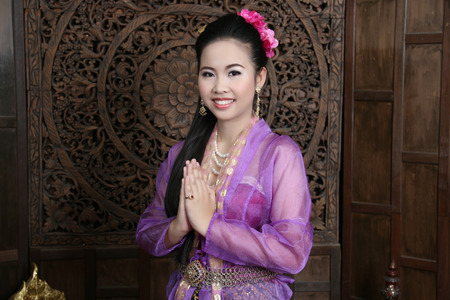 an obeisance: Asian woman dressed in Thailand shooting in the studio.
