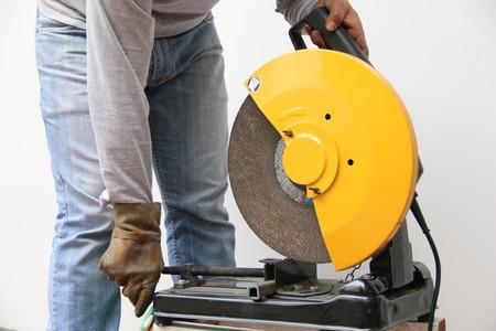 Machine cutting a metal object. photo