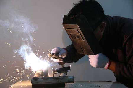 welding: worker welding steel Stock Photo