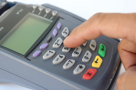 paying with credit card: Paying credit card on White Background. Stock Photo