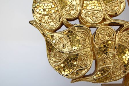 wood craft: Wood carvings, gold color, white background.