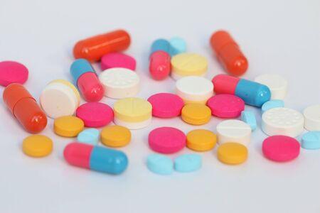 doses: Spilled pills of drug or alimentary supplement.