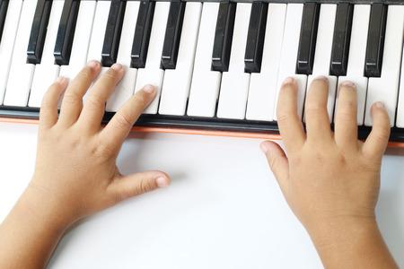 prodigy: playing keyboard on white background