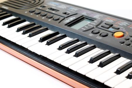 hymnal: close-up of piano keys. close frontal view.