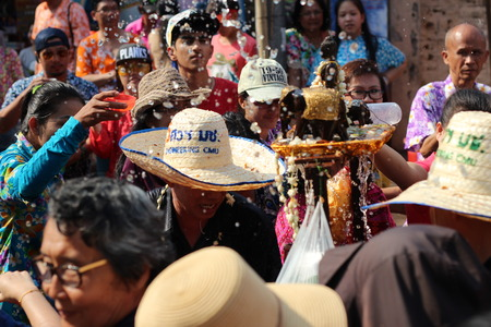 marched: CHIANG MAI THAILAND-APRIL 13:Chiangmai Songkran festival.The tradition of bathing the Buddha Phra Singh marched on an annual basis. With respect to faith.on April 13,2015 in Chiangmai,Thailand.