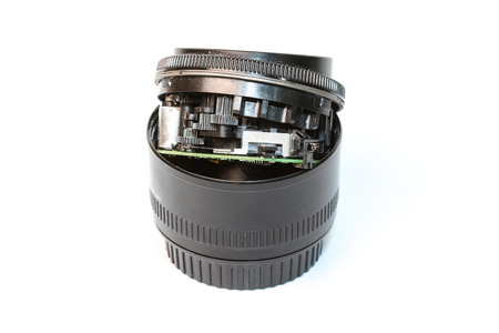 dslr: DSLR camera lenses that are worn on a white background.