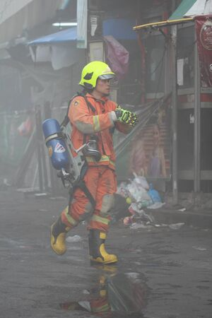trashed: Chiang Mai, Thailand . June 5 2015- Fire in Waroros province Chiang Mai, Thailand on June 5, 2015.
