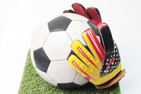 soccer goalkeeper: Soccer goalkeeper gloves and a ball Stock Photo