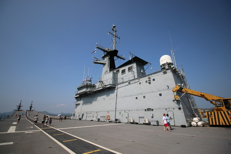 aircraft carrier: SATTAHIP, THAILAND - APRIL 17 2015: HTMS Chakri Naruebet aircraft carrier at Juksamet Port Sattahip. The port is one of the few deep-water ports of Thailand for Naval base and commercial ships.