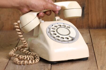 telephone line: Retro rotary telephone on wood table
