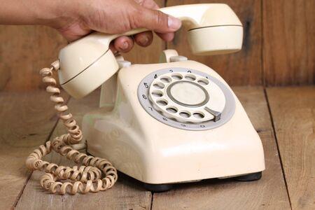antique telephone: Retro rotary telephone on wood table
