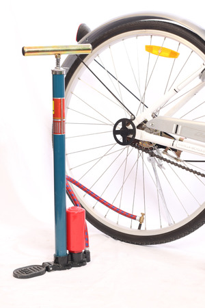 flaw: air pump with bicycle Stock Photo