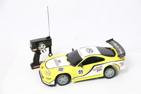 De autorafstandsbediening van het stuk speelgoed die op wit wordt geïsoleerd