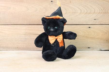 valentine s day teddy bear: Black bear on a wooden floor.