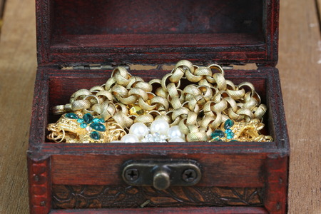 hidden success: Treasure chest standing on wooden table Stock Photo