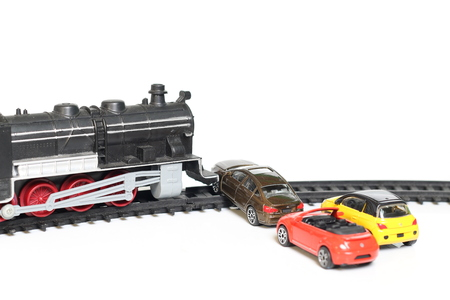 topple: Toys toy train collided with a car accident.