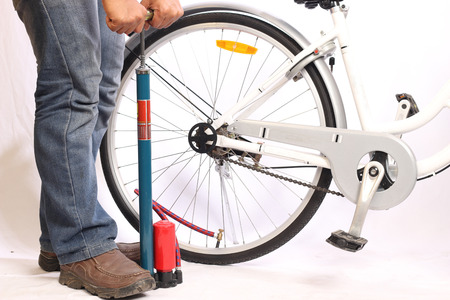 inflating: Inflating the tire of a bicycle