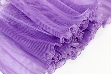chiffon: Pressing on a purple chiffon white background.