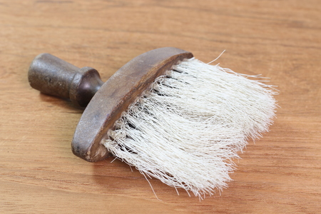 barber shave: vintage barber shaving brush On a wooden background.