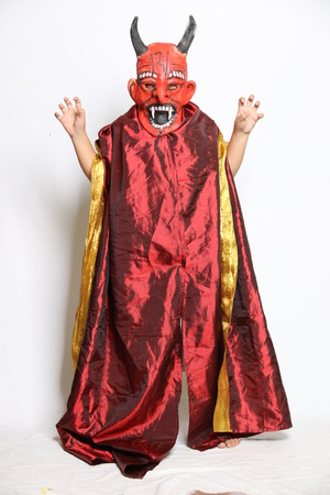 Boy in horror costume with mask isolated on white