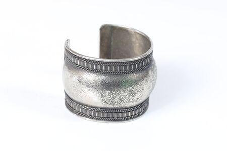 armlet: Silver old vintage bracelet isolated on white background Stock Photo