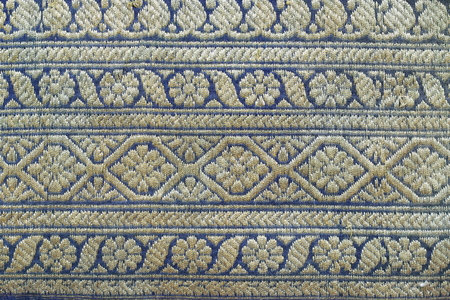 inserts: Thailand ancient striped fabric inserts gold. Stock Photo